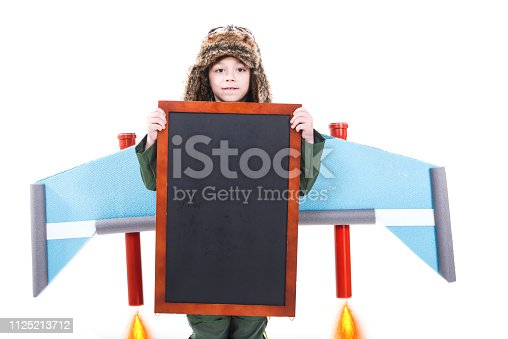 620402800istockphoto Boy holding black board 1125213712
