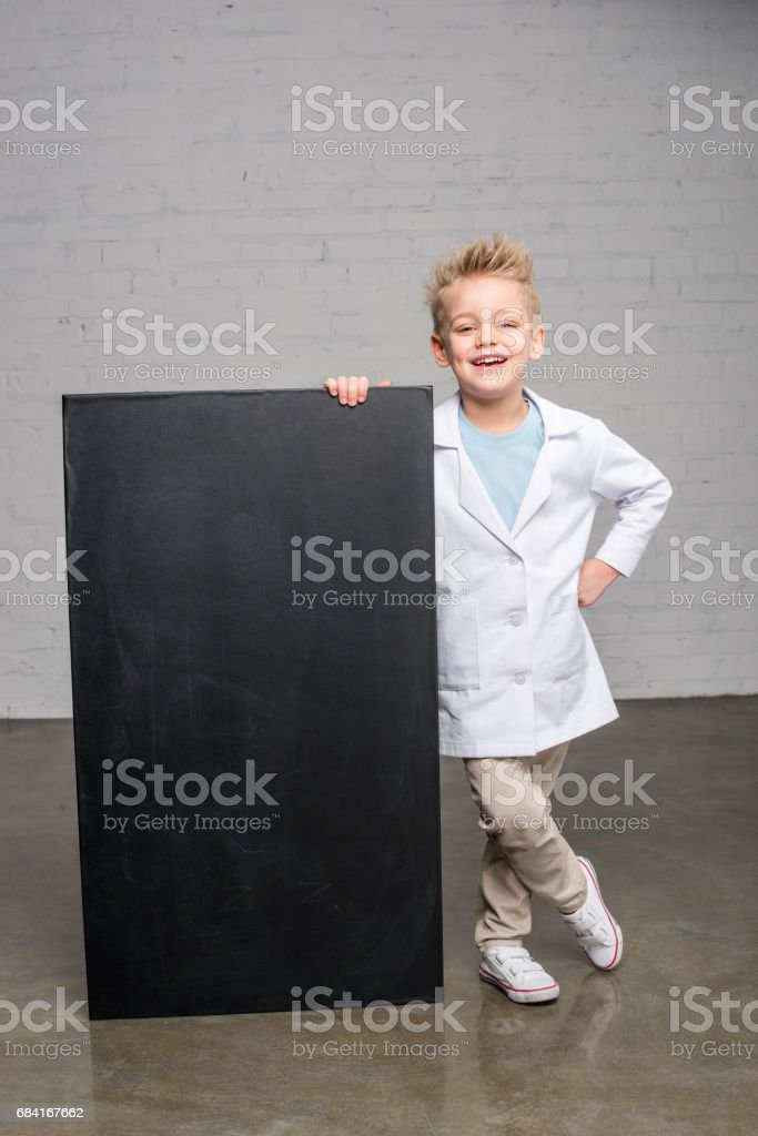 Boy holding blackboard royalty-free stock photo