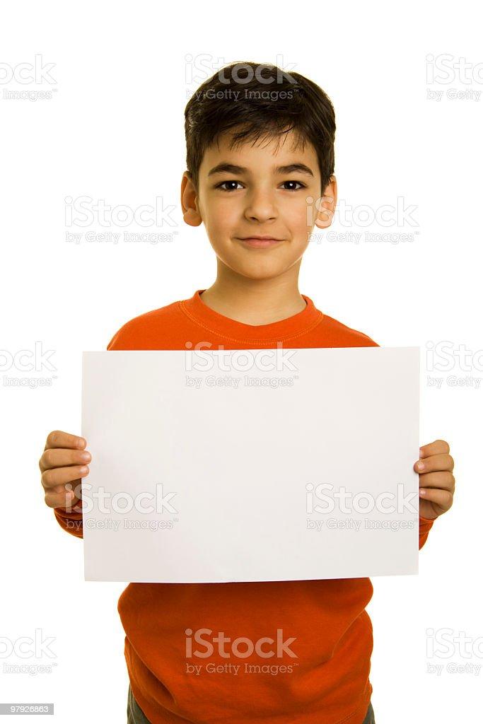 Boy holding blank paper royalty-free stock photo