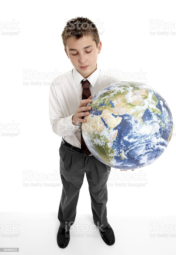 Boy holding blow up ball of the Earth world royalty-free stock photo