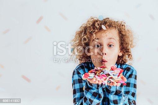 istock Boy holding confetti 656141932