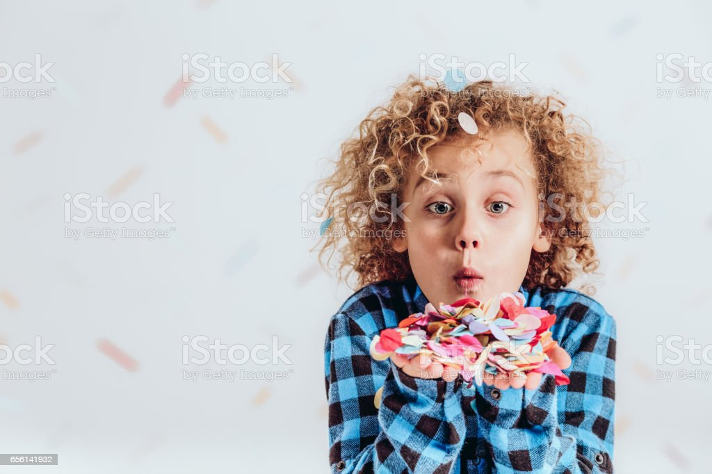 Boy holding confetti stock photo