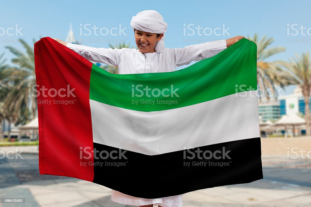 Boy Holding Flag stock photo
