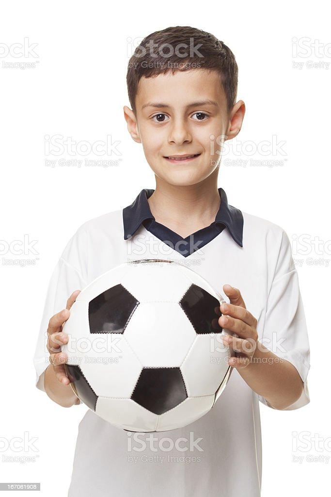 boy holding football stock photo