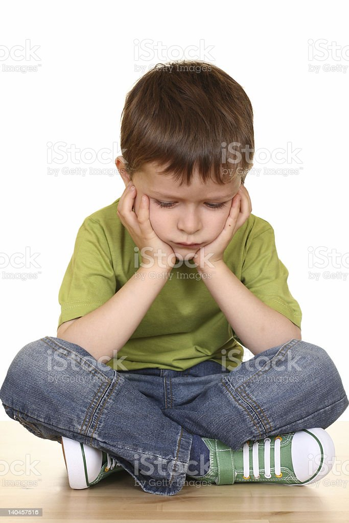 Boy holding his head on his hands on isolated background royalty-free stock photo