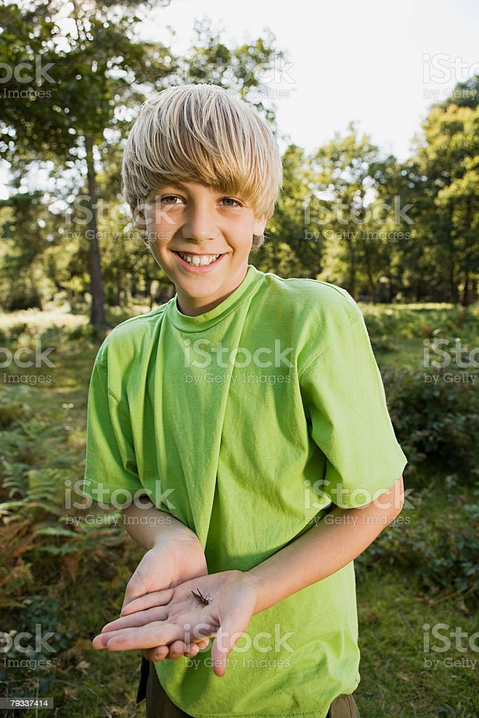 Boy holding insect royalty-free 스톡 사진