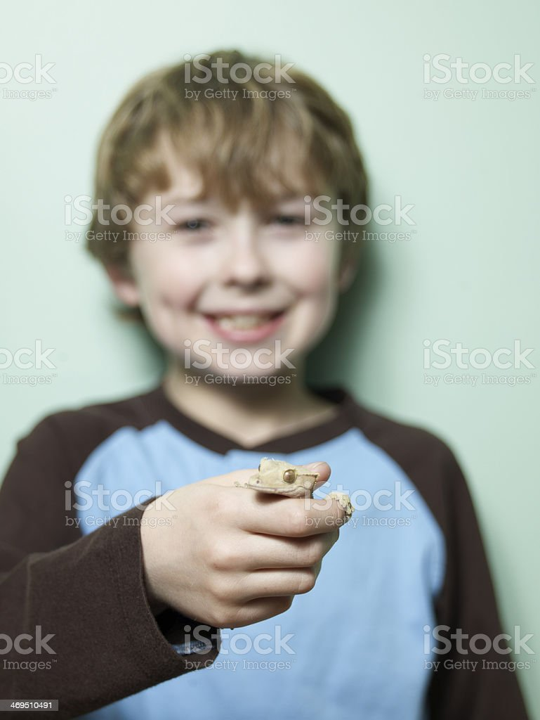 Boy Holding Lizard in Hand royalty-free stock photo