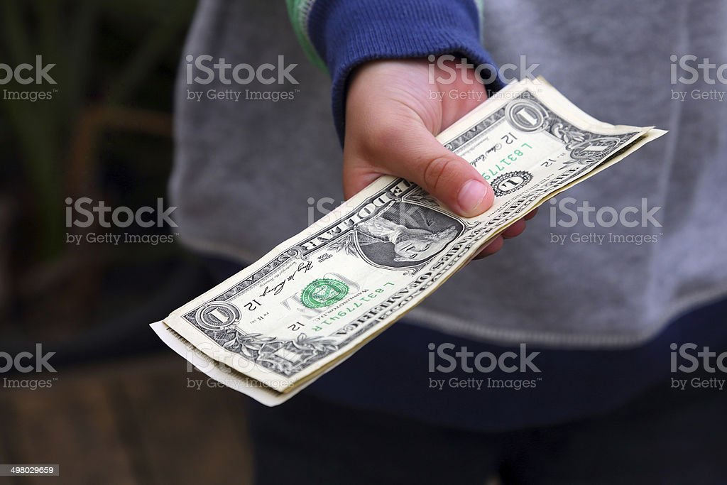 Boy Holding Money stock photo