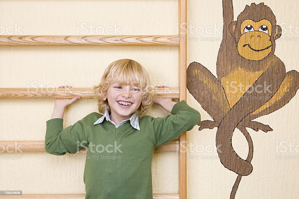Boy holding onto climbing frame royalty-free stock photo