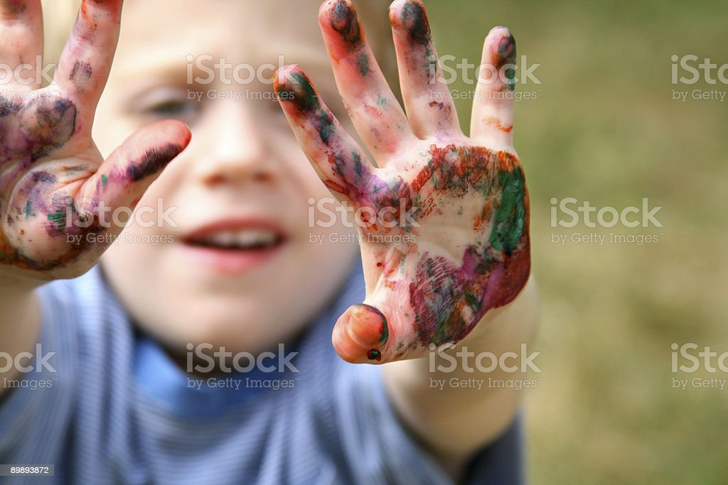 Boy holding out his Painted paint-covered Hands royalty-free stock photo
