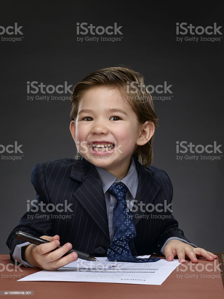 Boy (2-3) holding pen, smiling royalty-free stock photo