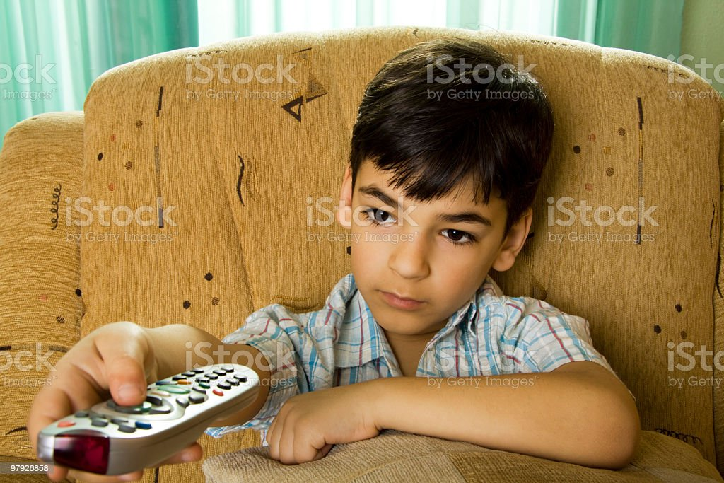 Boy holding remote control pad royalty-free stock photo