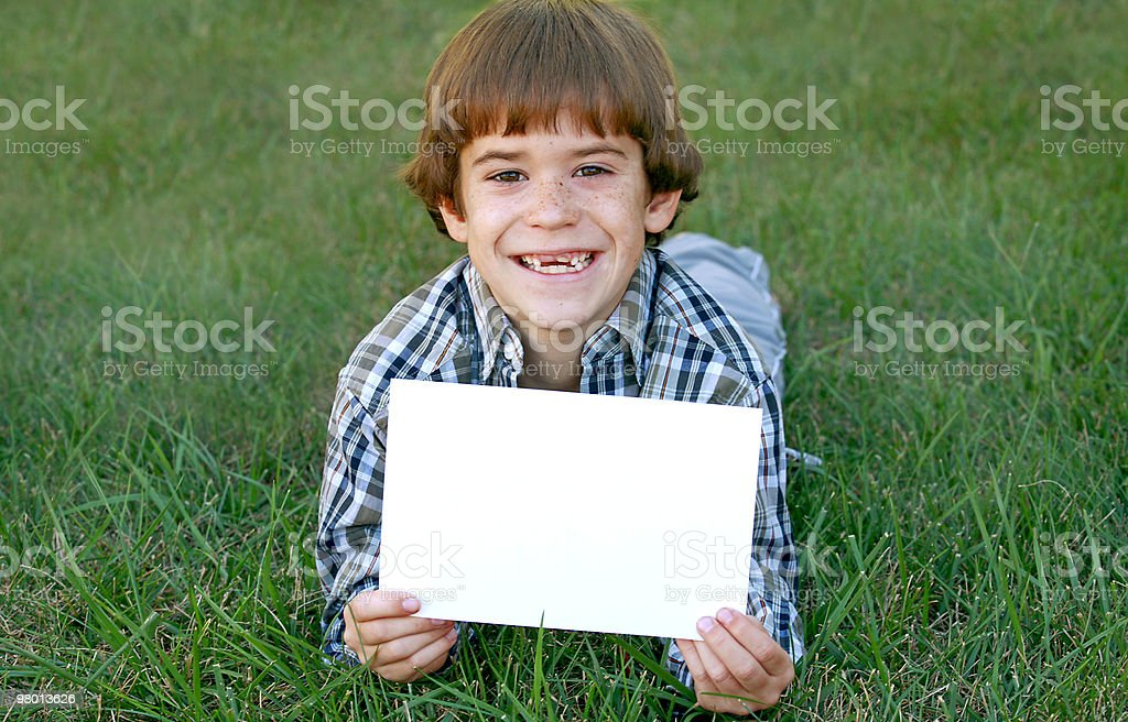 Boy Holding Sign royalty-free stock photo