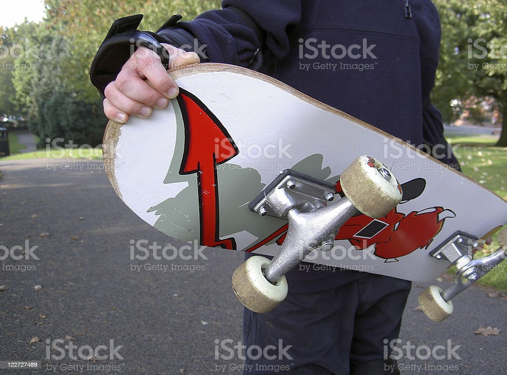 Boy holding skateboard royalty-free stock photo