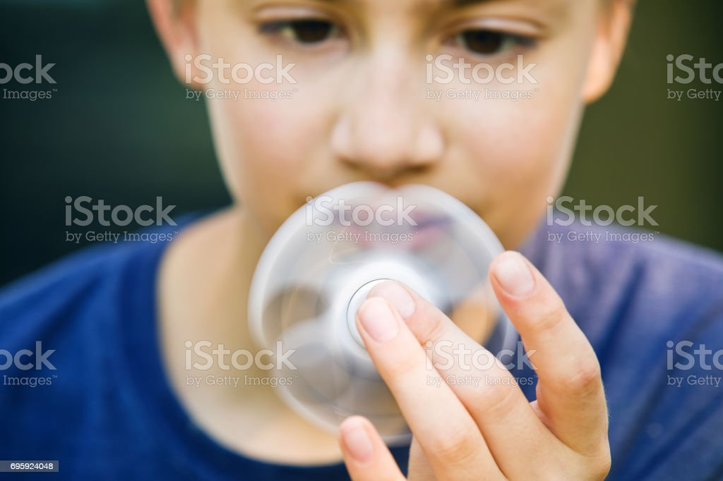 Boy Holding Spinner - Royalty-free 12-13 Years Stock Photo