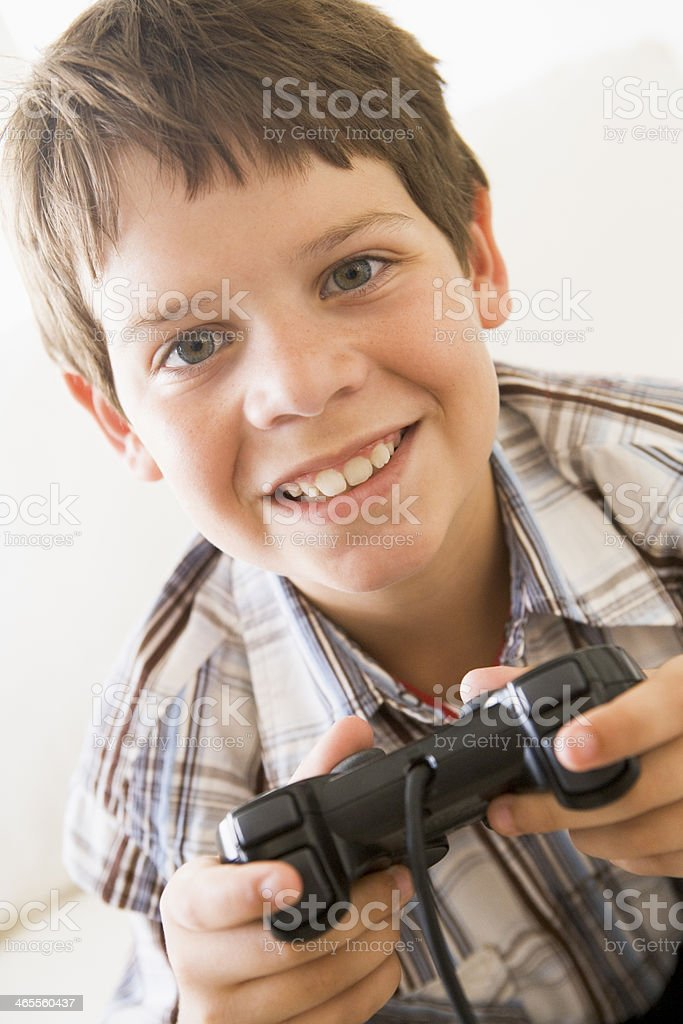 boy holding video game controller royalty-free stock photo