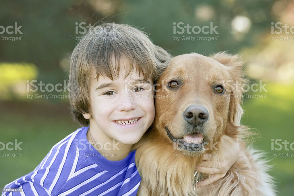 Boy Hugging Dog royalty-free stock photo
