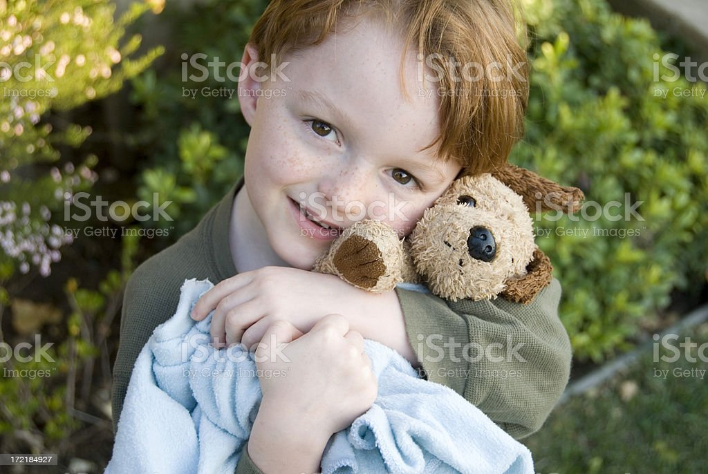 Boy Hugging Dog Stuffed Animal, Redhead Child Consoling with Blanket royalty-free stock photo