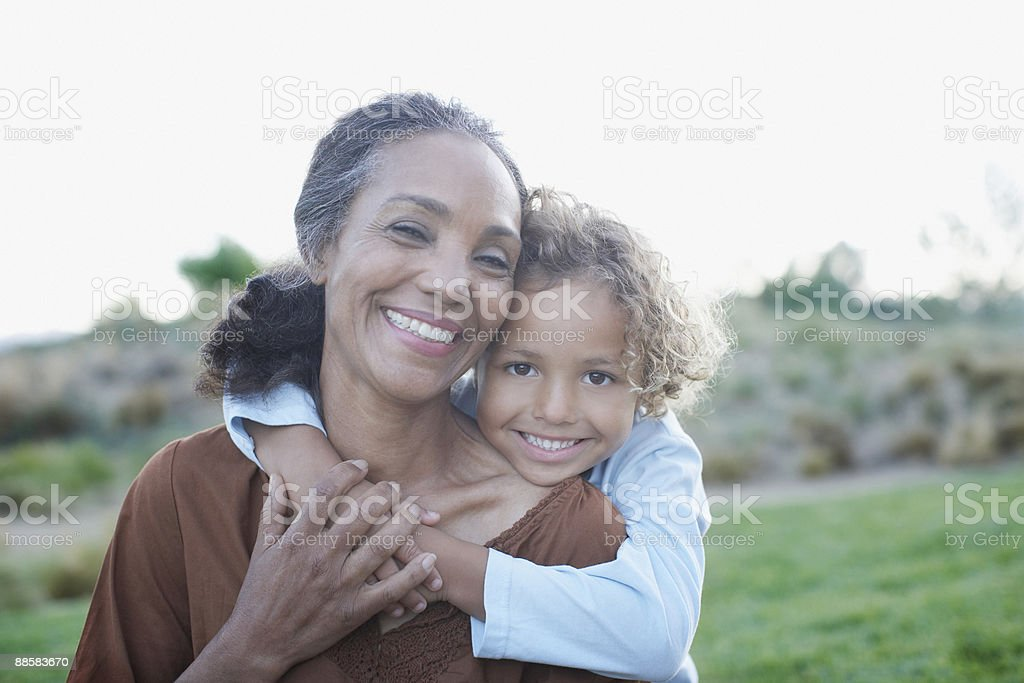 Boy hugging grandmother stock photo