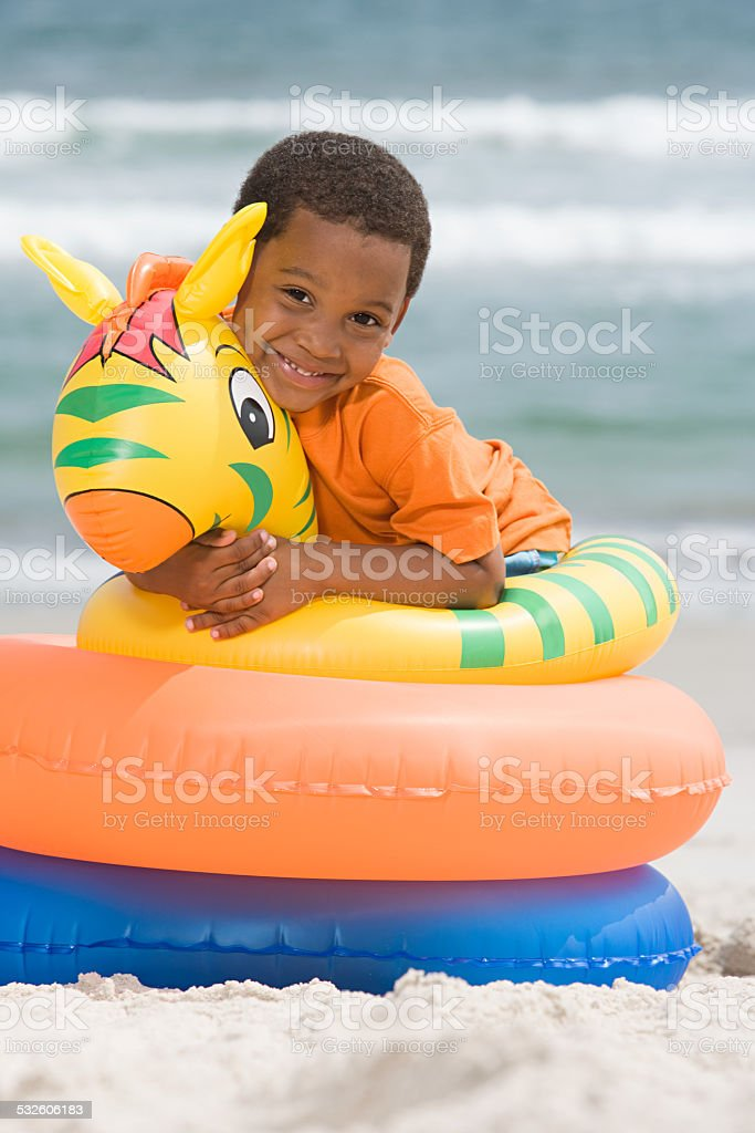 Boy hugging inflatable ring stock photo
