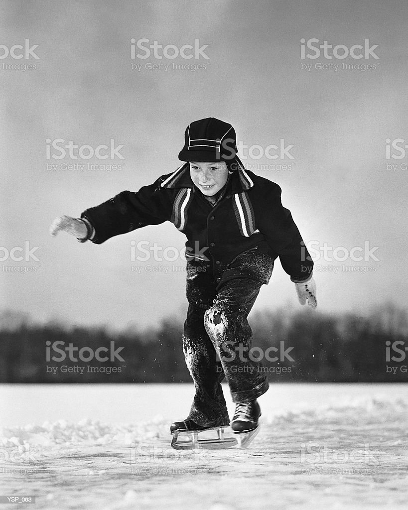 Boy ice-skating royalty-free stock photo