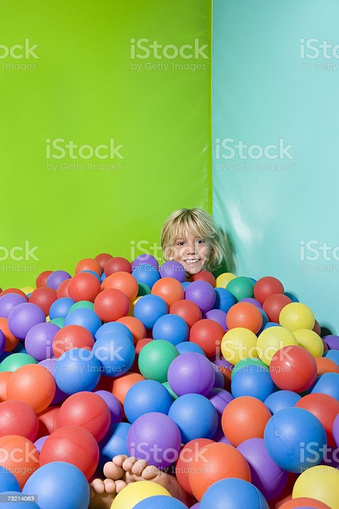 Boy in a ball pool royalty-free stock photo