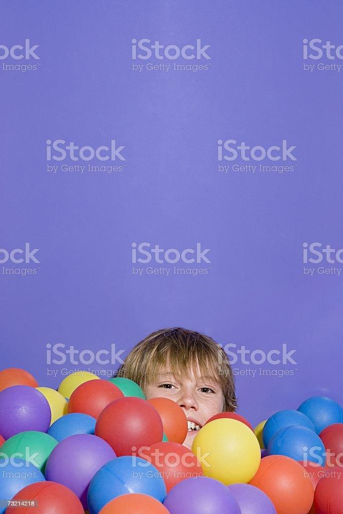 Boy in a ball pool stock photo