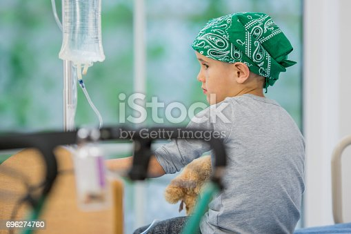 istock Boy in a Bandana Getting Leukemia Treatment 696274760