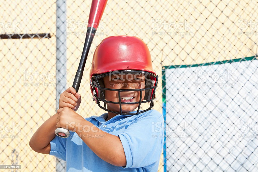 Boy in a batting cage royalty-free stock photo