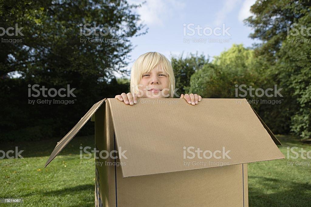Boy in a cardboard box royalty-free stock photo