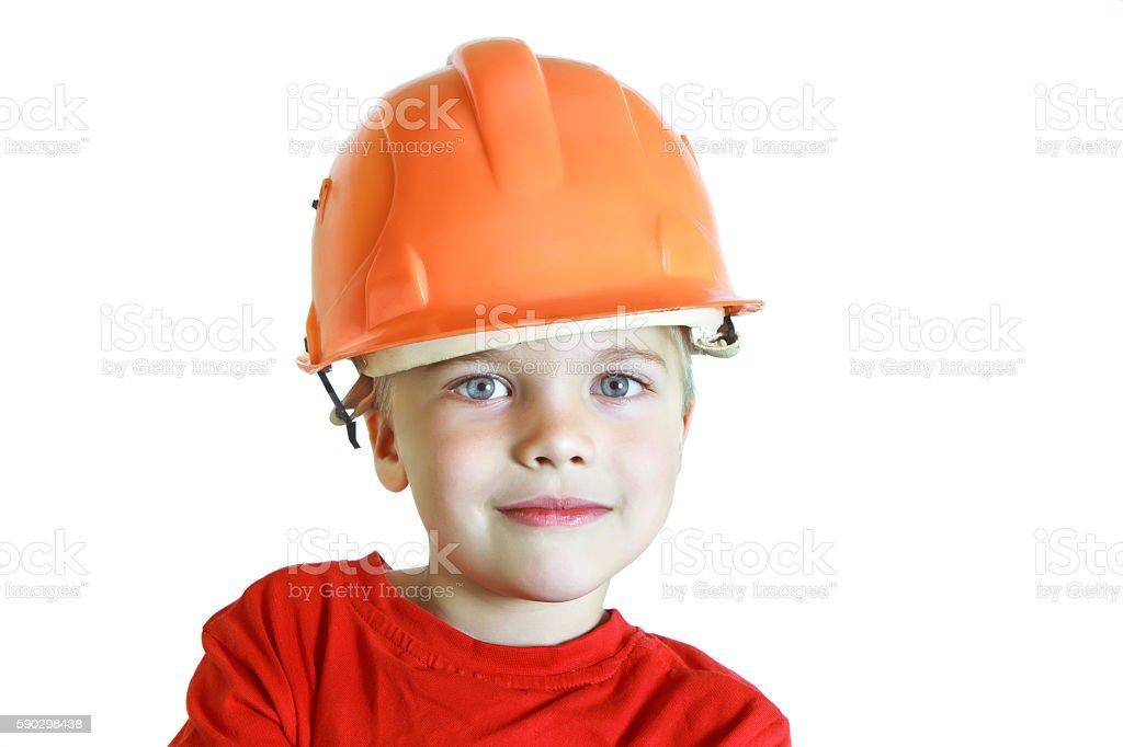 Boy in a construction helmet royaltyfri bildbanksbilder