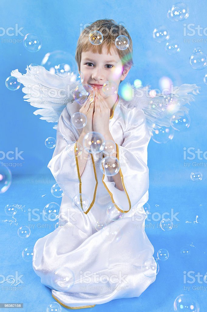 Boy in a costume with angel wings royalty-free stock photo