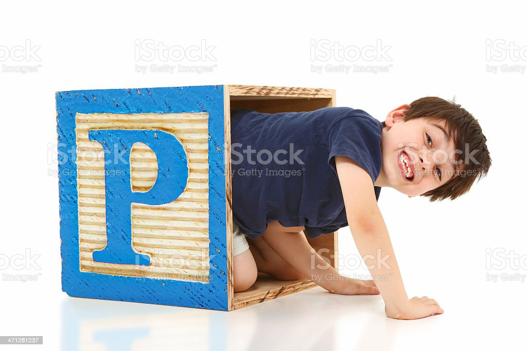 Boy in a Giant Alphabet Block Letter P stock photo