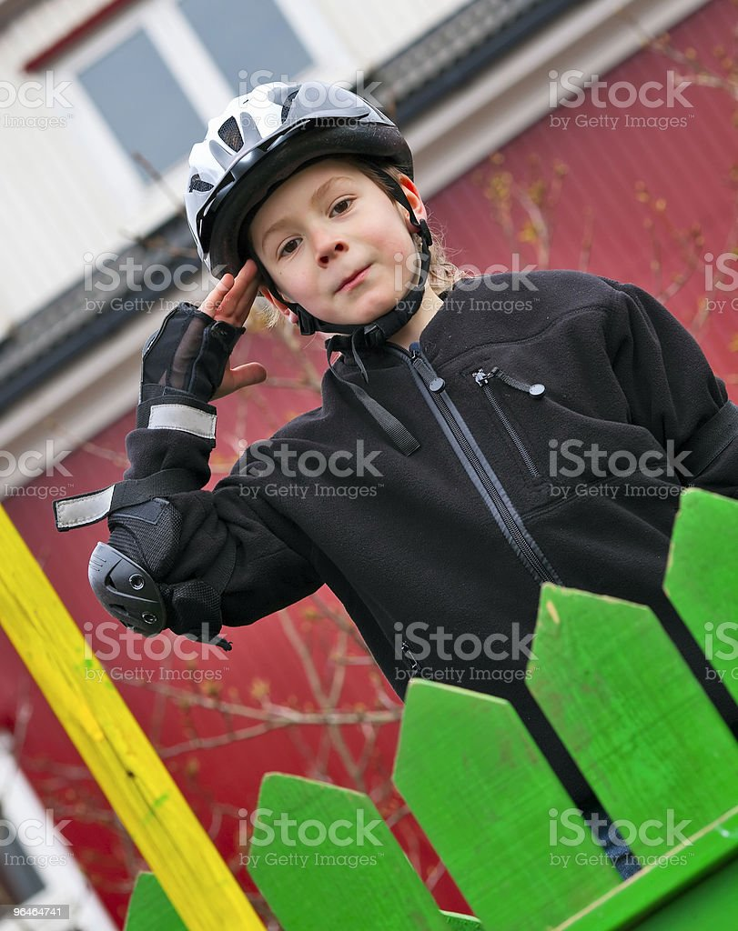 Boy in a helmet  salute royalty-free stock photo