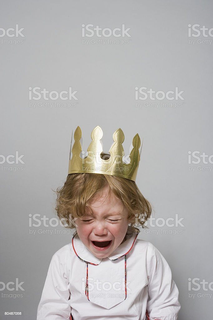 Boy in a party hat having a tantrum  stock photo