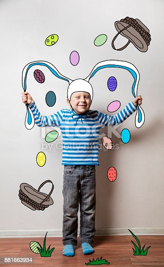 istock Boy in a rabbit costume, pulls his ears 881663934