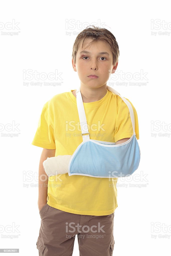 Boy in arm sling royalty-free stock photo