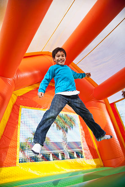 Boy in bounce house stock photo