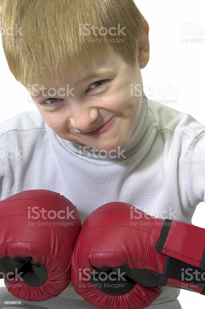 Boy in boxing gloves stock photo