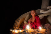 A boy in buddhism set fire with candle in bagan, Myanmar