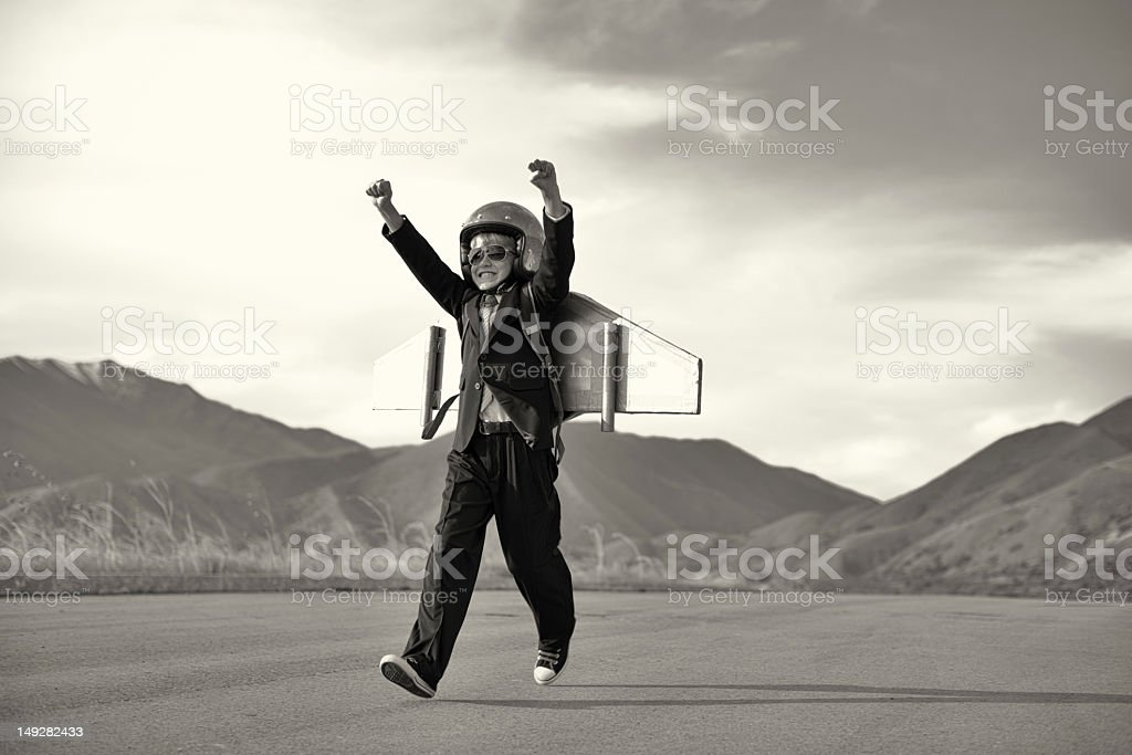 Boy in Business Suit Running with Jet Pack royalty-free stock photo