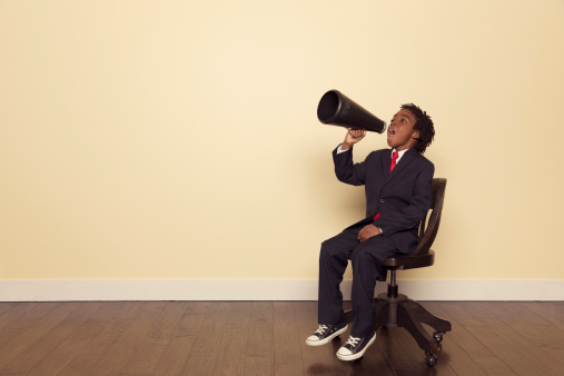 A young male businessman is ready to market your business message to the world.