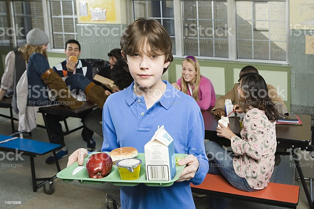 Boy in cafeteria royalty-free stock photo