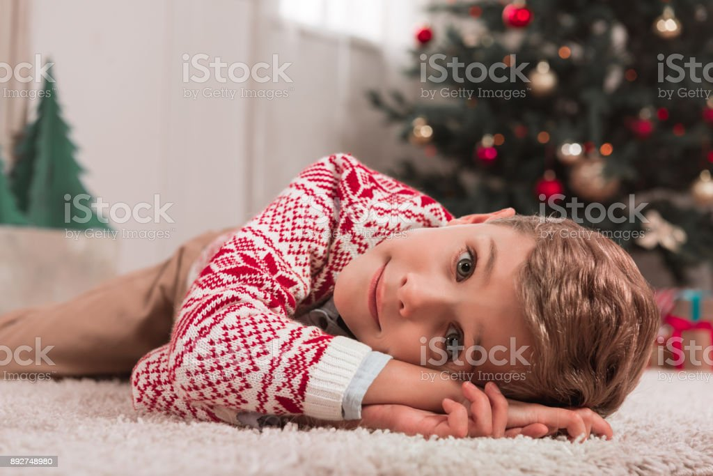 boy in christmas decorated room stock photo