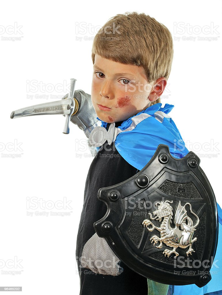 Boy in costume knight and with a sword royalty-free stock photo