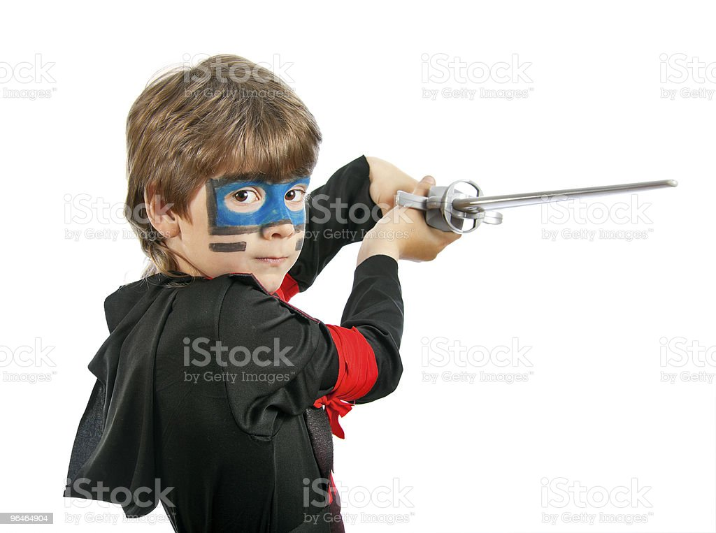 Boy in costume ninja and with a sword royalty-free stock photo