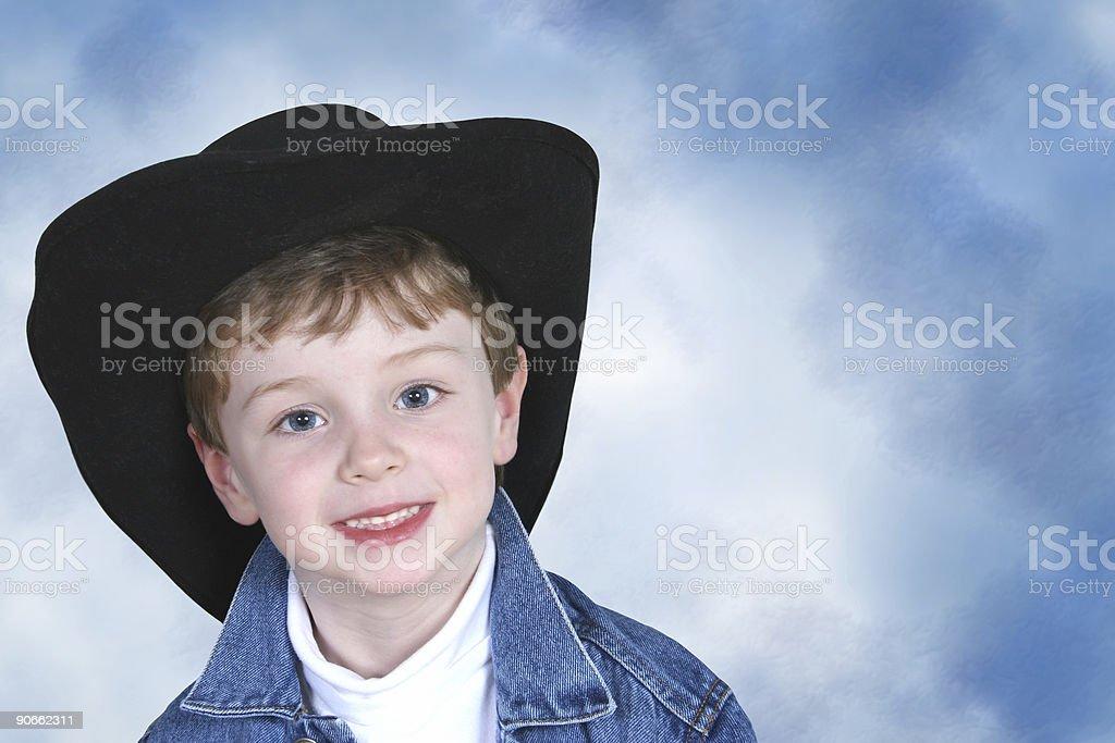 Boy in Denim Jacket and Black Cowboy Hat royalty-free stock photo