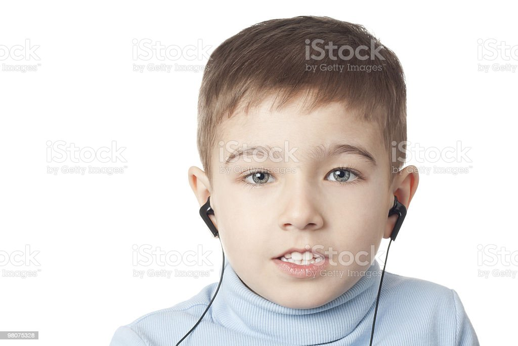 Boy in earphones royalty-free stock photo