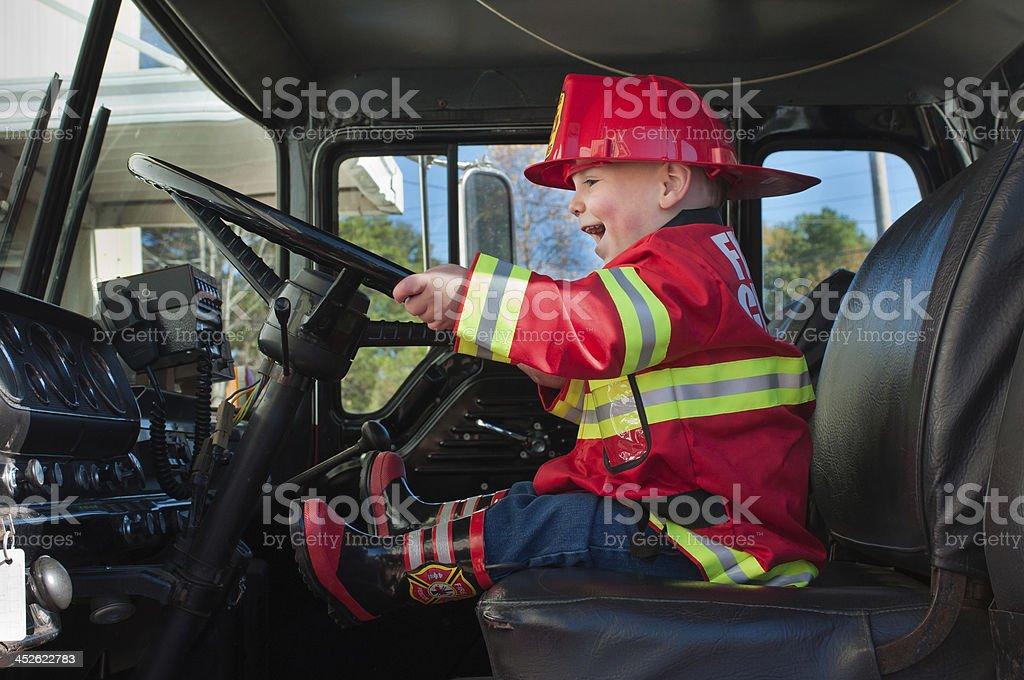 Boy in Fire Truck stock photo