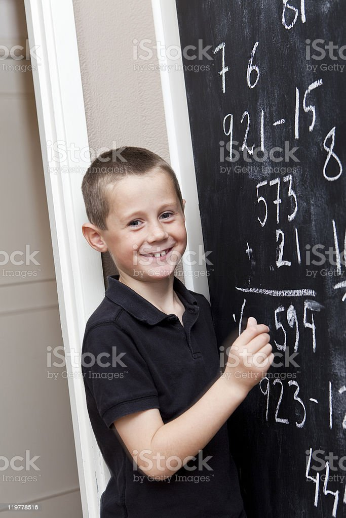 Boy in front of Blackboard royalty-free stock photo